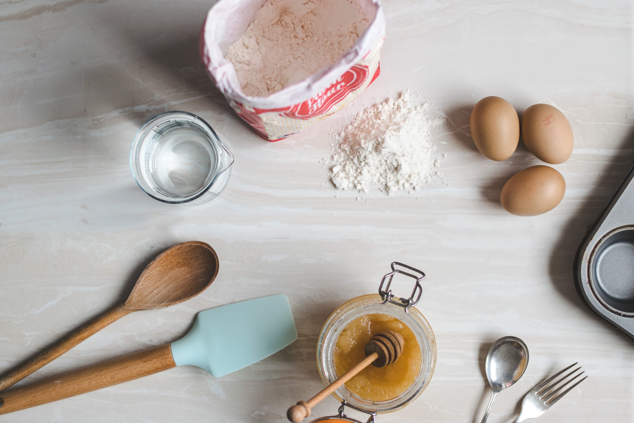 Picture of cooking ingredients on bench, including flour alternatives