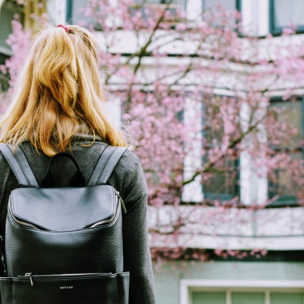 Picture of a woman with a backpack, embarking on free TAFE courses in Victoria
