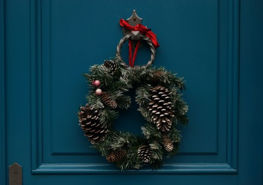 Festive Christmas wreath on a blue wooden door of a Christmas Day lunch in Melbourne