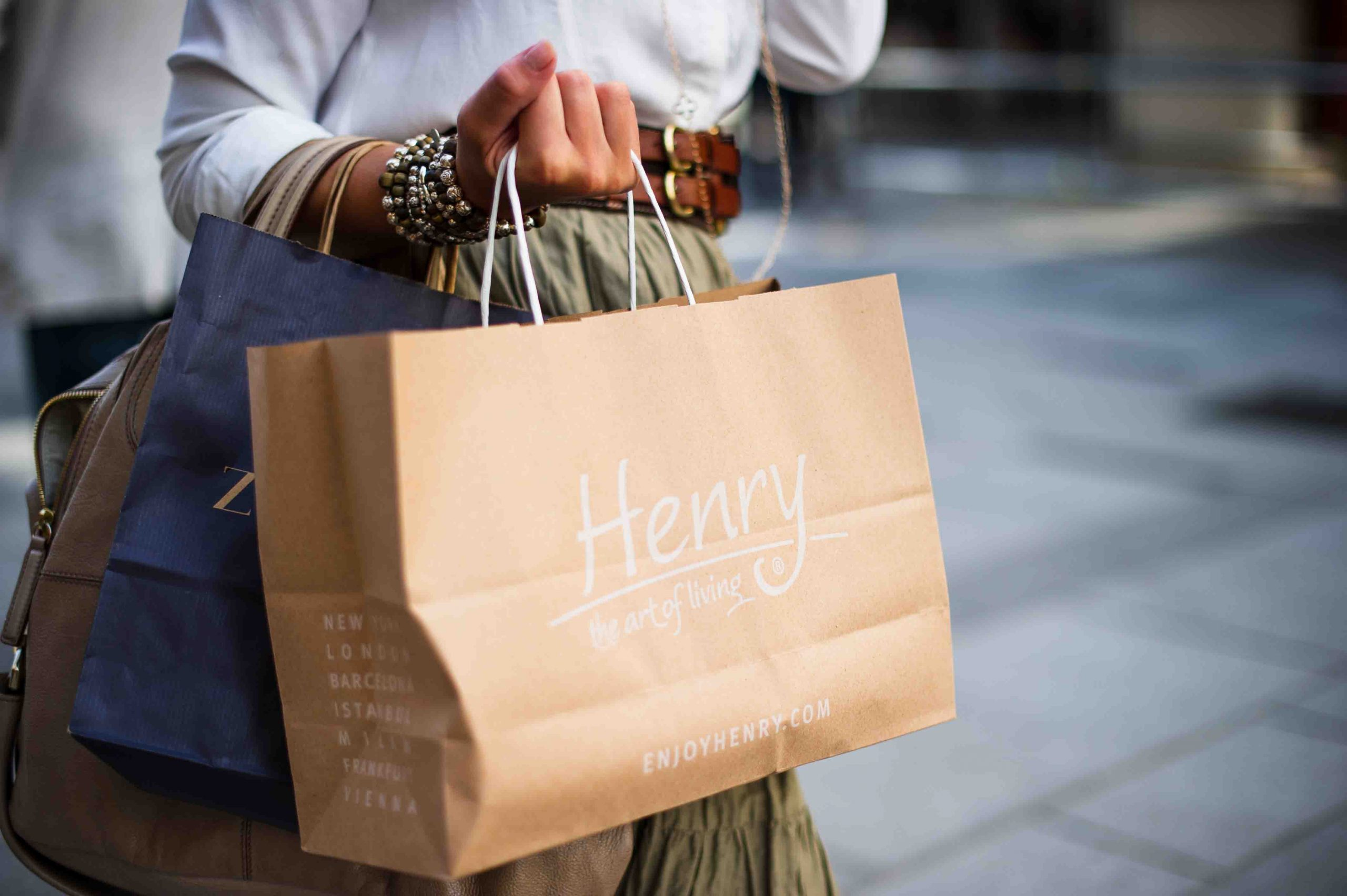 Woman holding bags from a spree at some of the best outlet shopping in Melbourne
