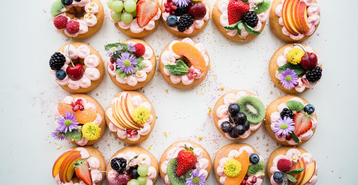 Picture of intricate pastries with flowers and fruit decorated on these boutique baked goods from a gluten-free bakery in Melbourne