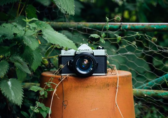 Picture of an analogue camera outside of a place for film developing in Melbourne